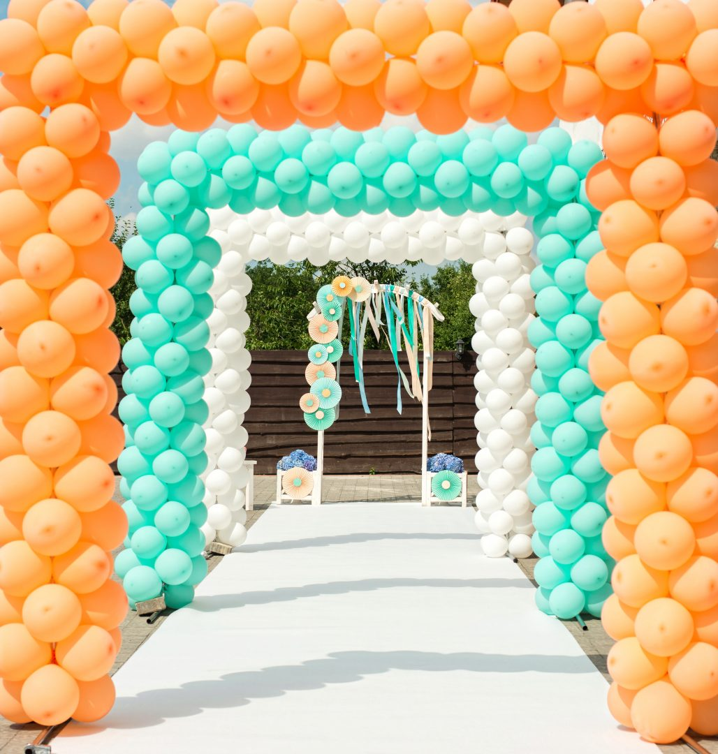 orange and green balloon arches