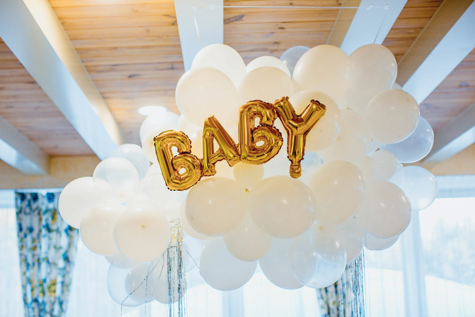 white and gold megaloon baby shower balloons